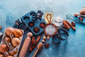 Baking utensils header. Muffin tin, sea salt, eggs, flour, oil and sugar with whisks and cookie cutters with copy space. Making pastry concept