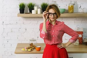 Girl with glasses in kitchen