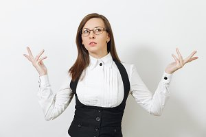 Beautiful smart pensive caucasian thoughtful young brown-hair business woman in black suit, white shirt and glasses isolated on white background. Manager or worker. Copy space for advertisement.