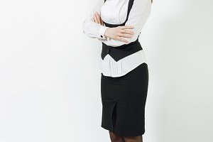 Full length portrait of beautiful caucasian young smiling brown-hair business woman in black suit, white shirt and glasses crossed hands isolated on white background. Copy space for advertisement.