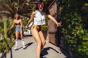 Female friends doing skateboarding