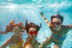 Underwater selfie of smiling females