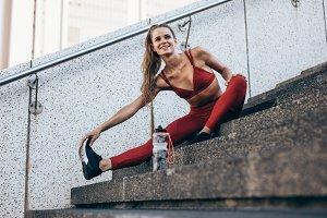 Runner loosening leg muscles