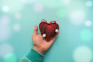 Woolen heart in hand