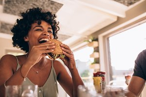 Woman enjoying eating burger