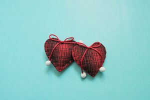 Two red woolen hearts