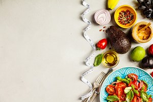 Healthy food and tape measure