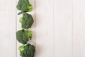 Fresh green broccoli.Wooden table