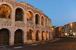 Verona, Italy. Ancient amphitheater Arena di Verona in Italy like Rome Coliseum with nighttime illumination and evening blue sky. Veneto region.