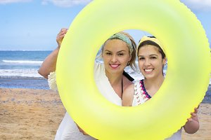 Women with a donut-shaped float.