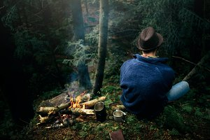 hipster traveler camping in forest