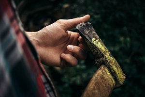lumberjack hand with ax