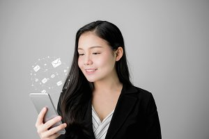 Business woman using smartphone and show icon social email, Concept of communication and working online.