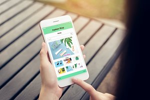 Women hold the smartphone and using shopping online store. The concept of providing marketing services on the internet for easy access to information.