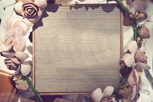 The Wooden board with beautiful flowers. vintage tone