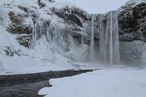 Skogafoss waterfall frozen