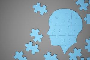 Blue jigsaw puzzle as a human brain. Creative idea concept. 3d illustration