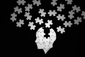 White jigsaw puzzle as a human brain on black. Concept for Alzheimer's disease. 3d illustration
