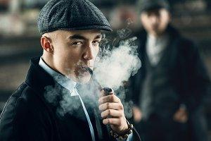 man smoking in retro clothes