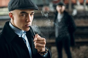 man smoking in retro clothes