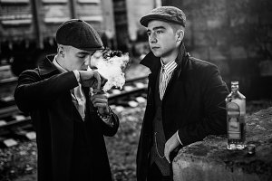 gangsters smoking in tweed outfit