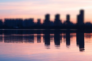 Abstract modern skyscrapers with water reflections background