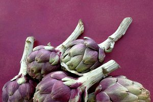 artichokes with garnet background