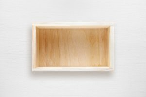 Wooden box on white table top view