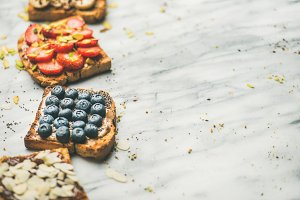 Vegan whole grain toasts with fruit, seeds, nuts, selective focus