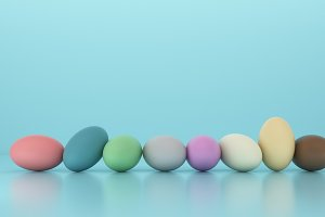 Row of colorful easter eggs on blue background, 3d render