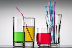 Tropical juices in glasses isolated
