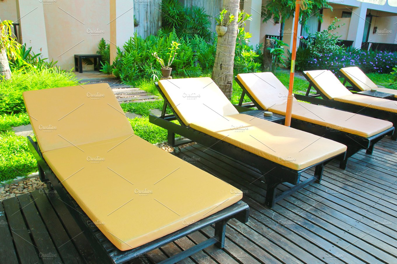 Beach chairs and swimming pool ~ Health Photos ~ Creative Market