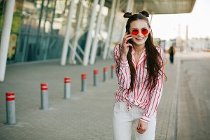 Pretty fashion model in red glasses