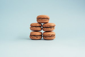 Macarons isolated on blue background