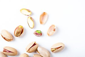 Pistachios nuts on white background