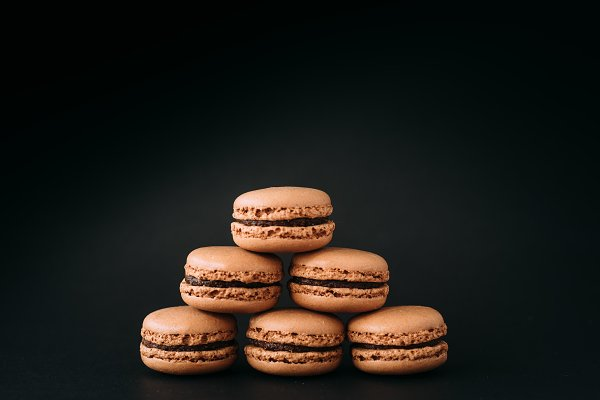 Close up of macarons isolated on bl…