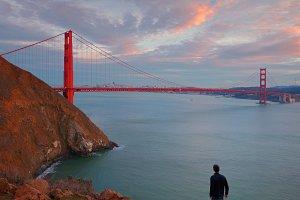 A Man is Looking at Golden Gate Bridge, California, USA