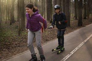 teenager kids roller skating skiing