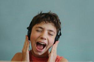 teen dj boy listening to favourite rock group track singing along