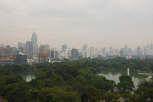 Lumpini Park with skyscrapers, Bangkok city, Thailand