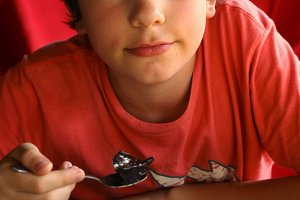 teenager sweet tooth boy eat lava cake in confectionery cofe shop