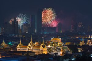 Fireworks glowing behind Grand Palace in Bangkok City, Thailand