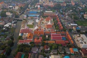 Flying above Wat Nang Ratchawihan in Bangkok City, Thailand.