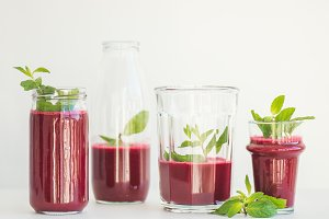 Fresh morning beetroot smoothie or juice in glasses, square crop