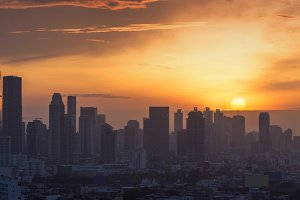 The sun goes down at Bangkok city, sunset time background