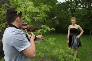 Photographer Instructing Model