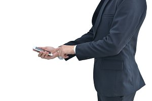 Business man using his phone isolated on white background, clipping path inside