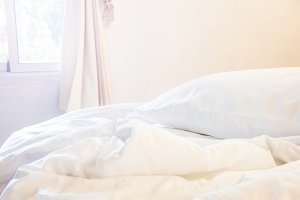 white pillow and blanket