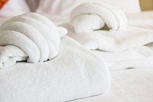 white towel on white mattress fabric