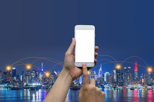 Hands touching smartphone in front of New York City background, social nets and network concept illustration